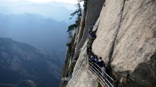 Entrance to the planks (that can be seen in the lower part of the picture), considered by many the most dangerous hiking trail in the world, Mount Hua, China