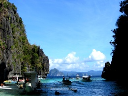 Bangkas loaded with tourist entering one by one in the canal that access to Big Lagoon. El Nido, Palawan