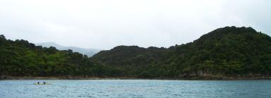 One kayak in front of the coast, Abel Tasman National Park